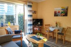 Das gemütliche Wohnzimmer hat einen direkten Zugang zu Ihrer ganz persönlichen Terrasse.